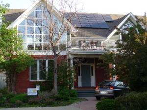 Solar panels on the sunny front roof of a house should be cheered, not banned. Photo credit: NREL