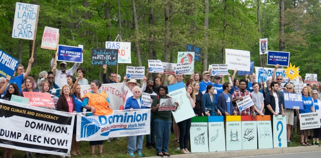 Protesters lined the road leading to the Dominion shareholder meeting in Richmond. Photo credit Corrina Beall.