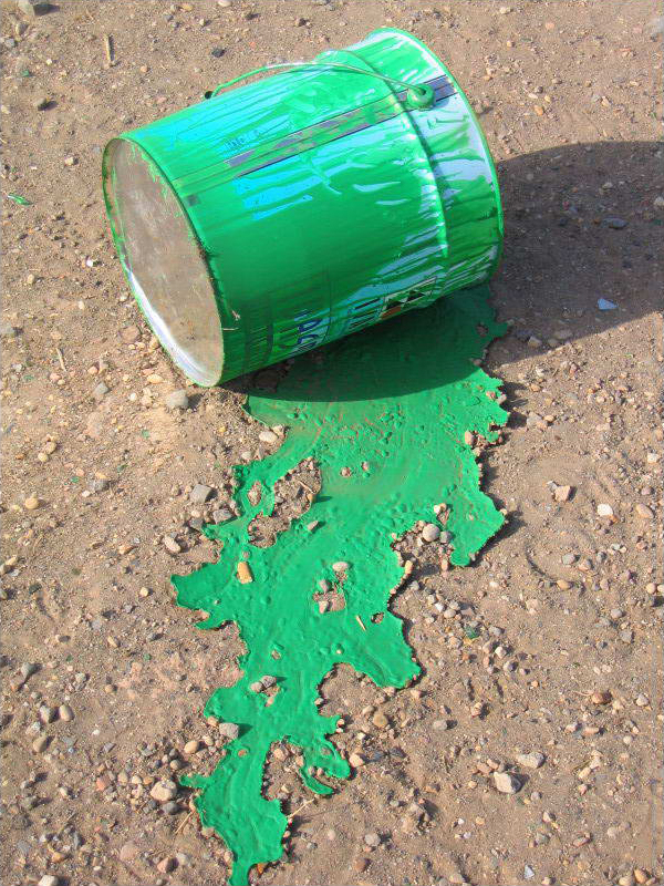 bucket of green paint with spill