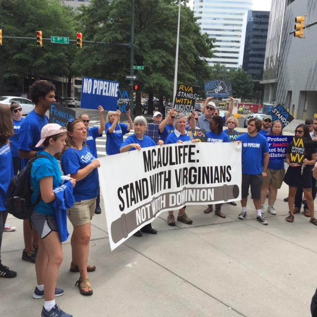 Protesters at an anti-pipeline rally aim their message at Governor McAuliffe