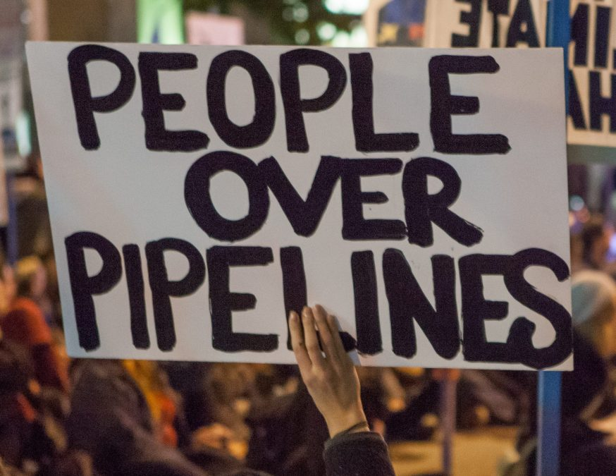 protest sign reading People Over Pipelines
