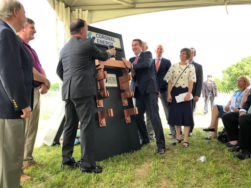 Governor Northam and CVEC CEO Gary Wood flip the switch on a solar farm