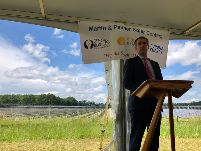 Virginia Governor Ralph Northam standing in front of a new solar farm.