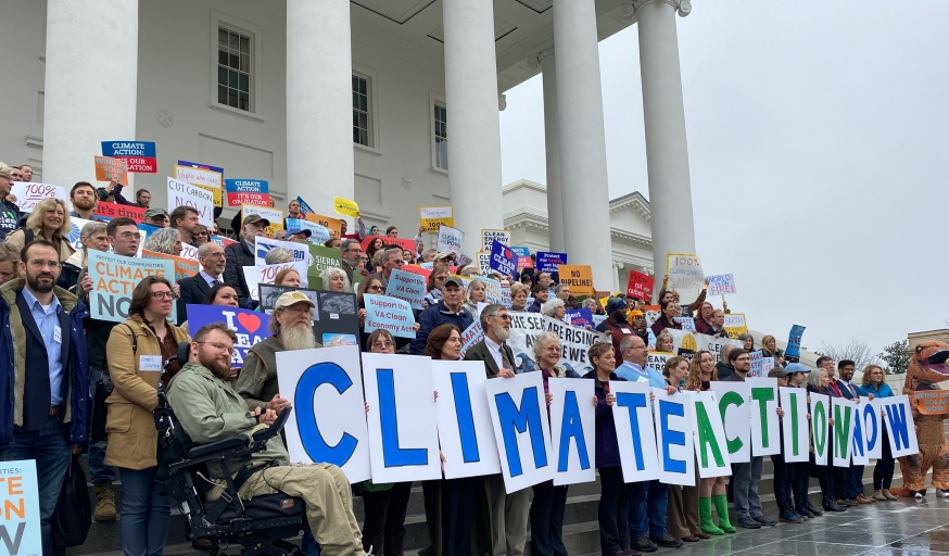 People gathered with signs supporting climate action
